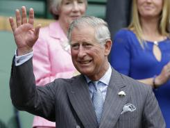 ORG XMIT: WIM140 Britain's Prince Charles waves as he arrives in the Royal Box for the start of a second round men's singles between Roger Federer of Switzerland Fabio Fognini of Italy during a match at the All England Lawn Tennis Championships at Wimbledon, England, Wednesday, June 27, 2012. (AP Photo/Kirsty Wigglesworth)