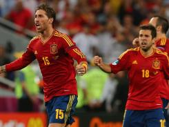 Sergio Ramos of Spain celebrates after scoring on in a penalty shootout against Portugal.