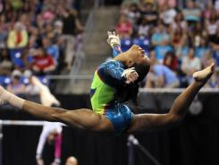Gabby Douglas competes on the floor exercise during day two of the 2012 Visa Championships in St. Louis on June 10.