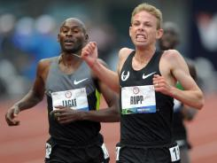 Galen Rupp (right) defeats Bernard Lagat to win the 5,000m during the U.S. Olympic Team Trials at Hayward Field.