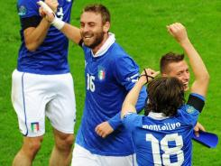Italy players celebrate after defeating Germany to advance to championship game.