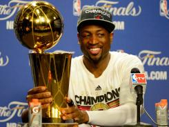 Dwyane Wade helped the Heat to the NBA title despite dealing with an injured knee that will require surgery.