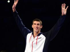 Phelps waves to the crowd after winning the 200 butterfly at the Olympic swimming trials on Thursday in Omaha.