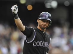 The Rockies' Marco Scutaro celebrates after hitting a walk-off single in the bottom of the 11th inning against the Nationals at Coors Field.