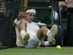 Rafael Nadal of Spain tumbles to the court during his second-round loss to Lukas Rosol of the Czech Republic on Thursday at Wimbledon.