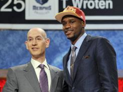 NBA Deputy Commissioner Adam Silver, left, poses with Florida State's Bernard James, who was selected in the second round of the NBA draft.