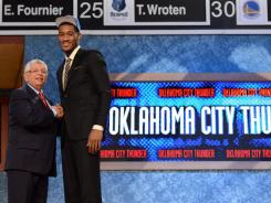 Perry Jones III shakes NBA Commissioner David Stern's hand after being drafted 28th by the Thunder.