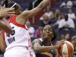 Connecticut Sun guard Danielle McCray, right, looks to pass the ball against Washington Mystics guard Noelle Quinn during the first half of Friday's game.
