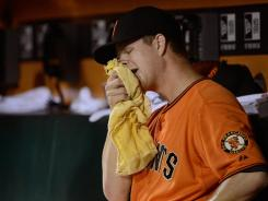 The Giants' Matt Cain allowed five earned runs and 11 hits against the Reds.