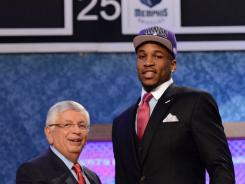 Thomas Robinson, right, is introduced as the No. 5 overall pick to the Sacramento Kings by NBA commissioner David Stern during the 2012 NBA draft at the Prudential Center in Newark, N.J.