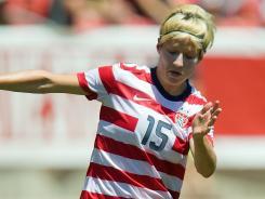 U.S. midfielder Megan Rapinoe dribbles up field during the first half against Canada.