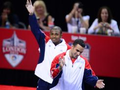 Danell Leyva, front, and John Orozco celebrate after being named to the U.S. Olympic team after the Olympic trials in San Jose on Saturday.