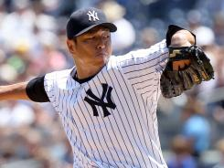 Yankees pitcher Hiroki Kuroda struck out 11 in a win against the White Sox on Saturday.