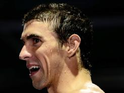 Michael Phelps beat Ryan Lochte to win the men's 200-meter individual medley final at the U.S. Olympic swimming trials on Saturday in Omaha.