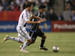 Todd Dunivant of the Los Angeles Galaxy and Rafael Baca of the San Jose Earthquakes vie for the ball in the second half the two team's last meeting on May 23.