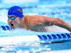 Ryan Lochte competes in the men's 100 butterfly semifinal in the U.S. Olympic swimming trials Saturday in Omaha.