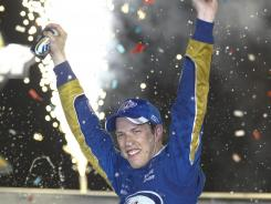 Brad Keselowski celebrates his third win of the season in victory lane at Kentucky Speedway.