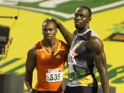 Jamaican sprinter Usain Bolt congratulates Yohan Blake for his victory in the men's 200-meter dash final of the Jamaican Olympic trials.