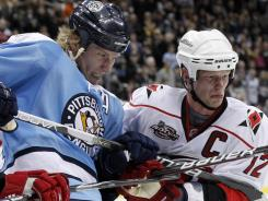 Jordan Staal, left, signed a 10-year deal with Carolina, where he joined brother Eric after a June trade.