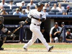 New York second baseman Robinson Cano hit a two-run home run to lead the Yankees past the Chicago White Sox Sunday.