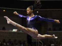 Douglas soars above the balance beam during the U.S. Olympic gymnastics trials in San Jose on Sunday.