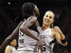 San Antonio Silver Stars' Sophia Young, left, and Becky Hammon celebrate after Young scored against the Minnesota Lynx during their win on Sunday.