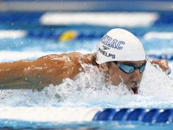 Michael Phelps was sixth at the turn but rallied to win the men's 100 butterfly in 51.14 seconds Sunday night during the Olympic trials. The 100 fly is one of Phelps' favorite races.