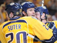 The Predators hope for a quick decision by Ryan Suter because it also affects what they do with Shea Weber (center).