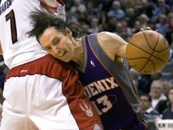 Suns point guard Steve Nash, shown here playing against the Raptors, is considering Toronto as a free agent.