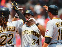 Pirates third baseman Pedro Alvarez, center, is congratulated by teammates after his first-inning grand slam, his 15th home run of the year.