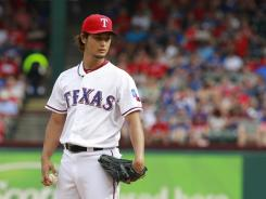 Rangers pitcher Yu Darvish struckout 11 batters against the Athletics on Sunday but registered his first home loss of the season.