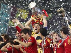 Spanish captain Iker Casillas leads his teammates in celebration after winning the European Championship.