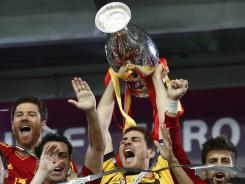 Spain goalkeeper Iker Casillas lifts the trophy after the Euro 2012 soccer championship final between Spain and Italy.
