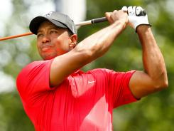 Tiger Woods tees off the first hole Sunday on his way to a 2-under-par 69 and his second victory in the AT&T National at Congressional Country Club.