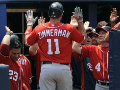 The Nationals' Ryan Zimmerman (11) is congratulated on his home run in the fifth inning.