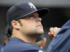 Yankees pitcher Joba Chamberlain, seen here in 2011, is set to throw a simulated game on Friday, less than four months after injuring an ankle while playing on a trampoline with his son.