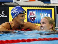 Dara Torres (left) congratulates Jessica Hardy in the women's 50-meter freestyle semifinals at the U.S. Olympic trials Sunday.