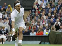 Roger Federer of Switzerland chases down a return Monday in his four-set victory against Xavier Malisse of Belgium.