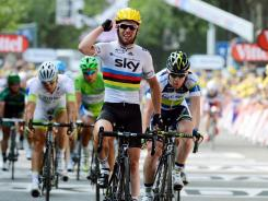 Mark Cavendish celebrates after winning Stage Two between Vise and Tournai.
