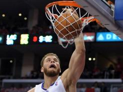Los Angeles Clippers forward Blake Griffin dunks the ball during the Western Conference semifinals against the San Antonio Spurs at the Staples Center on May 20. He's among a group of players competing for a spot on the U.S. Olympic team.
