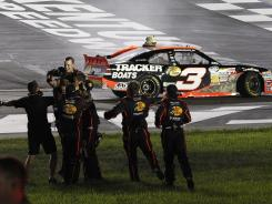Austin Dillon celebrates his first career Nationwide Series win with his crew at Kentucky Speedway.