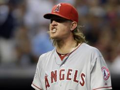 Angels starter Jered Weaver reacts after striking out Cleveland's Shelley Duncan with the bases loaded to end the seventh inning.
