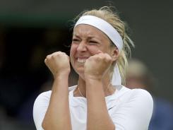 Sabine Lisicki of Germany celebrates after defeating No.1-ranked Maria Sharapova of Russia in the fourth round Monday at Wimbledon.