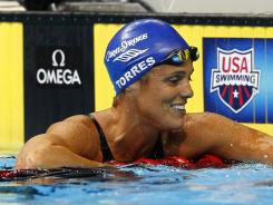 Dara Torres, 45, celebrates Sunday after advancing to the women's 50-meter freestyle finals, but she failed to qualify Monday for the Olympics.