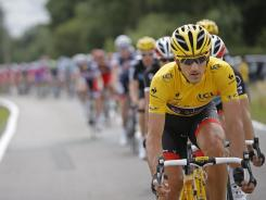 Fabian Cancellara of Switzerland, wearing the overall leader's yellow jersey, rides in the pack during the third stage of the Tour de France.