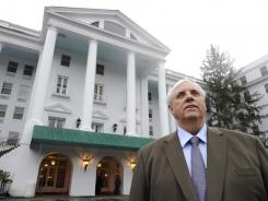 Jim Justice stands outside his resort, the Greenbrier, which this week hosts the PGA Tour in the Greenbrier Classic.