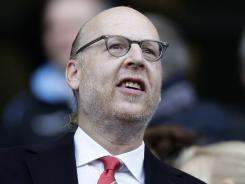 Avram Glazer, joint-chairman of Manchester United, takes his seat before the team's English Premier League soccer match against Manchester City at The Etihad Stadium. The Glazer family bought the club in 2005.