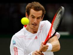 Andy Murray of Great Britain muscles a backhand during his fourth-round victory Tuesday against Marin Cilic of Croatia.