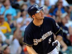 Ryan Braun watches his 3-run home run against the Miami Marlins in the sixth inning at Miller Park.