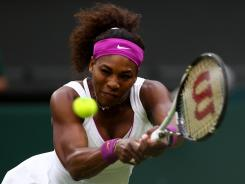 Serena Williams of the USA lines up a backhand during her tough quarterfinal matchup against defending champion Petra Kvitova of Czech Republic on Tuesday at Wimbledon.